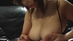 Hot Asian babe with big tits give tit wank to white cock