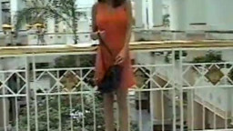 Babe In Orange Dress Flashes In Mall p(movie0005.mpeg)