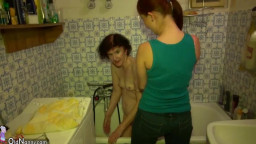Old granny and teen bathing and toying