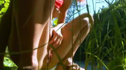 Petite russian girl peeing in a forest